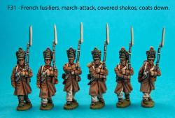 F31 Six centre company figures in march-attack poses.