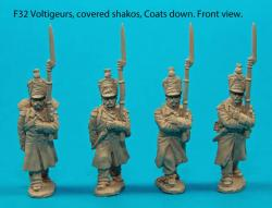 F32 – Four voltigeurs in march-attack poses with covered shakos and coats down