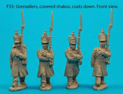 F33 – Four Grenadiers in march-attack poses with covered shakos and coats down