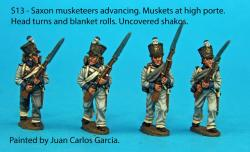 S13 - Advancing Saxon musketeers, muskets held at high porte, uncovered shakos. 2 figures with heads turned and two with greatcoat rolls.