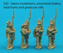 S42 - Four Saxon musketeers in march attack poses. Head turns and greatcoat rolls. Uncovered shakos.